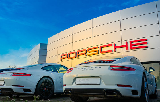 Nuremberg, Germany - October, 2019: Porsche cars in front of Porsche store in Nuremberg. Porsche is a German automobile manufacturer specializing in high-performance sports cars, sedans and SUVs