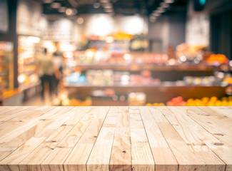 Wood texture table top (counter bar) with blur grocery,market store background