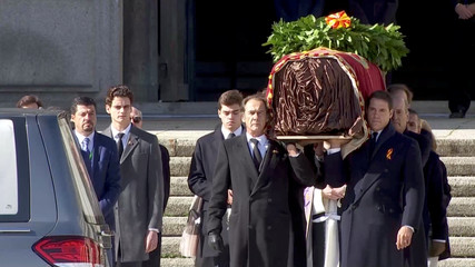 A still image taken from a video shows relatives carrying the coffin with the remains of Spanish late dictator Francisco Franco as they leave the basilica at The Valle de los Caidos (The Valley of the Fallen) in San Lorenzo de El Escorial