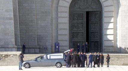 A still image taken from a video shows relatives placing the coffin with the remains of Spanish late dictator Francisco Franco into a hearse as they leave the basilica at The Valle de los Caidos (The Valley of the Fallen) in San Lorenzo de El Escorial