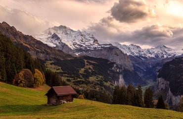 View from the village of Wengen into Lauterbrunnen valley with Jungfrau mountain in autumn / Blick vom Dorf Wengen ins herbstliche Lauterbrunnental mit Jungfraumassiv