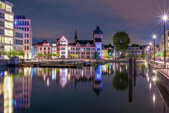Amazing nightscape of Hoerde Castle and Phoenix Lake in Dortmund, Germany illuminated at night