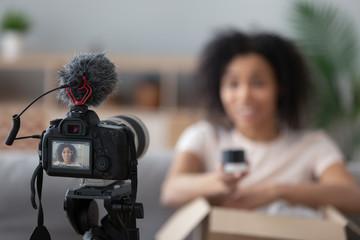 Professional camera shooting black female unpacking vlog