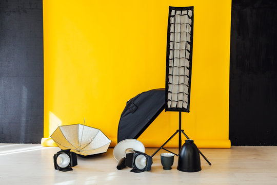 photo studio equipment of the room with a yellow background