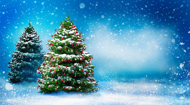 Beautiful snowy Christmas background with two New Year trees. Christmas tree decorated with red balls and snow. Winter landscape with snowfall.