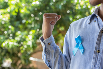 Blue ribbon on the chest of a man Prostate cancer awareness.