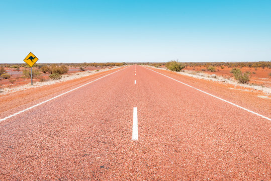 Kata Tjuta National Park, Northern Territory/ Australia - 10 13 2018: Road along the Uluru Ayers Rock through the red center of Australia a round trip with the camper