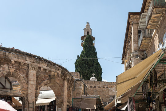 View from Shuk Hatsabaim Street at the gates of Abatimus Market and Omar Mosque in the Old City in Jerusalem, Israel