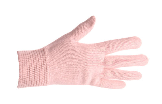 Woman wearing pink glove on white background, closeup. Autumn clothes