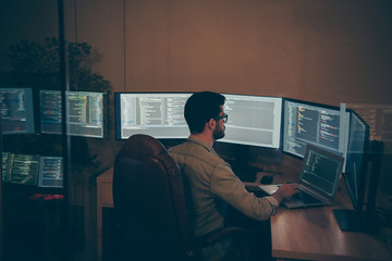 Photo of it-specialist working on global project using laptop testing alpha version of newly developed software checking bug existence debugging script code