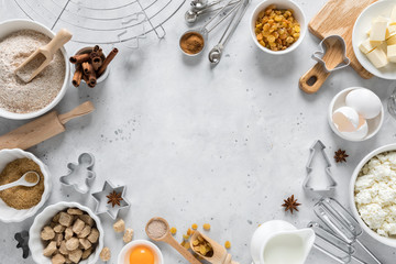 Christmas or Xmas baking culinary background. Ingredients for cooking on kitchen table. New Year or Noel holiday festive decorations