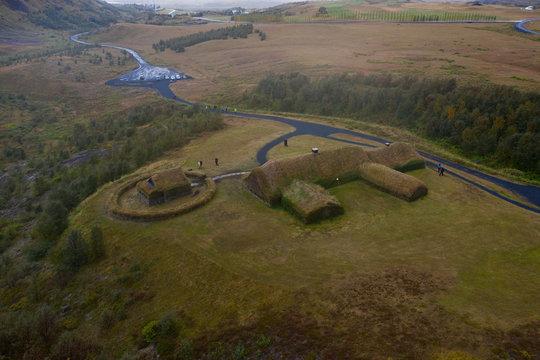 Traditional turf viking's house. Þjóðveldisbærinn Stöng. Iceland. Aerial drone shot. September 2019