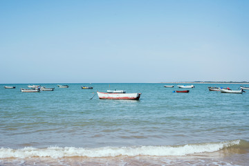 Little boats on the sea. Daylight and blue water.