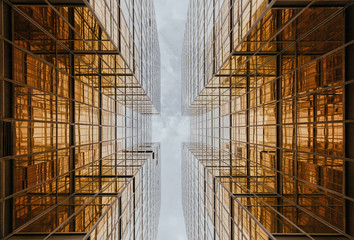 Buildings reflecting each other in wide windows