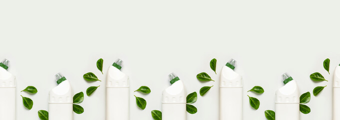 Seamless Pattern of White plastic bottle for liquid detergent cleaning agent bleach antibacterial gel with natural plant extract and green leaves on white background Eco style cleaning concept Flatlay