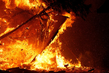 A burning structure collapses during the Kincade fire in Geyserville, California