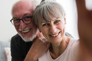 Cool elderly couple taking a selfie
