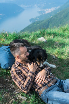 Man relaxing and having fun with his dogs into the wild