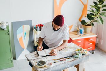 Artist working a sketch