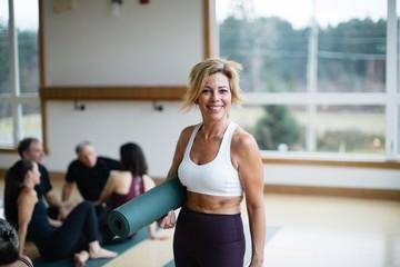 Mature, middle age yoga woman portrait.