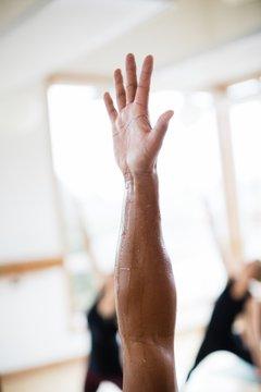 Sweaty yoga hand and arm