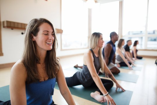 Smiling woman in yoga class pose