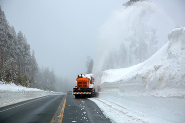 Vehicle clearing snow from the streets in the Sierras