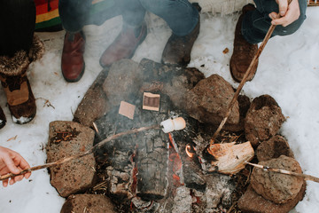 Group of Friends Making S'mores around Campfire