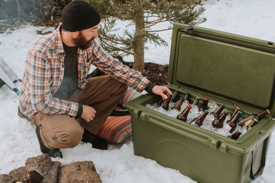 Man Grabbing Beer from Ice Chest Cooler