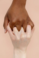 Black and white hands clasped together
