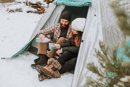 Couple Drinking Wine at Campsite