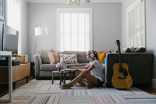 Teen Lifestyle image of Girl Listening to Music on Headphones