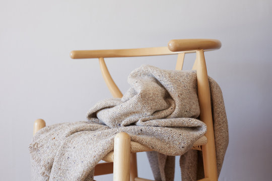 Wood seat with wool blanket