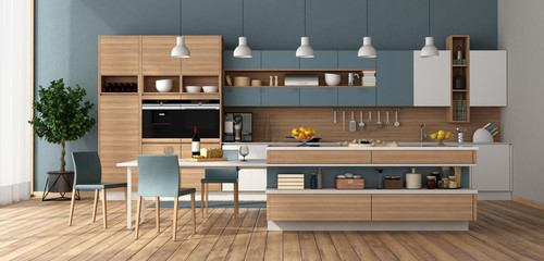 Modern kitchen with island and dining table