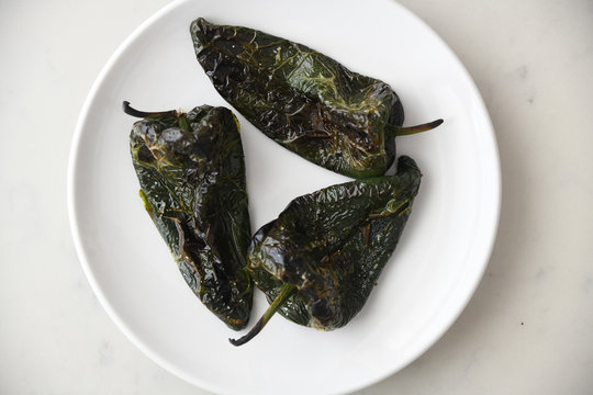 Close up of roasted poblano peppers served on plate