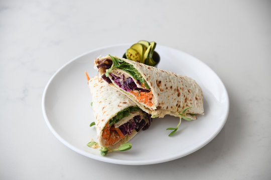 Close up of tortilla wrap served on plate