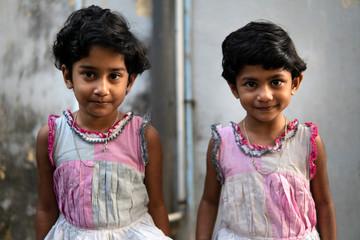 Twin girl looking at camera