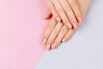Foto op Canvas Manicure Beautiful Woman Hands. Spa and Manicure concept. Female hands with pink manicure. Soft skin, skincare concept. Beauty nails. over beige background.