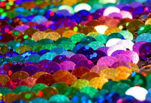Close-up of bright rainbow colored sequins