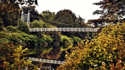 Howley suspension footbridge at victoria park. This bridge is around 100 years old and is hidden gem in warrington town - England. This could be a good calendar photo.