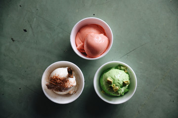 Overhead view of scoops of ice cream in cups