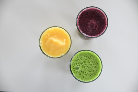 Overhead view of fruit smoothies served in glasses