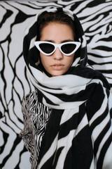 Elegant lady in zebra headscarf and sunglasses
