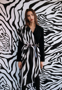 Woman wearing clothes with zebra print
