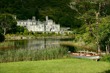 Rowboat in front of  Abbey and reflection, Kylmore Abbey, connemara, Ireland