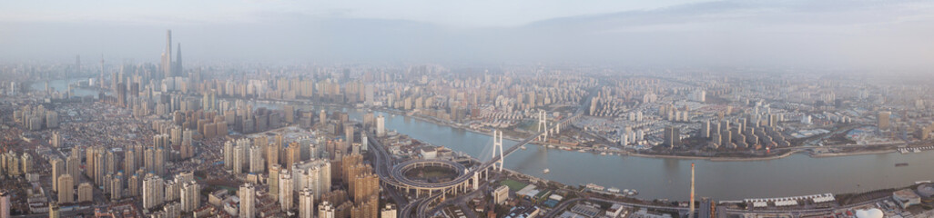 Sunset aerial panorama of the Bund and Lujiazui city landmarks, Shanghai, China Fototapete