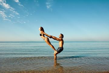 acro-yoga at beach