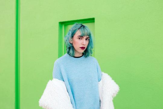 Teenage girl with blue hair