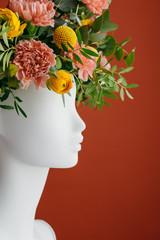 Flowers inside a mannequin?s head.