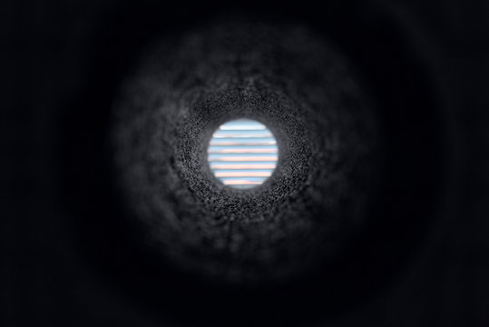 View through vent hole in concrete wall